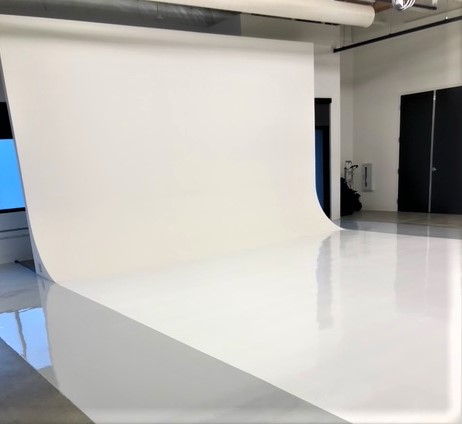white urethane cement was used to create an invisible backdrop for photoshoots