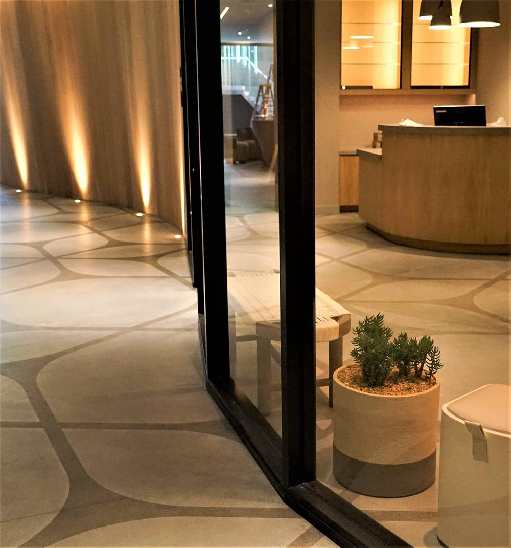 stenciled concrete lobby with inviting pattern to show dynamic design