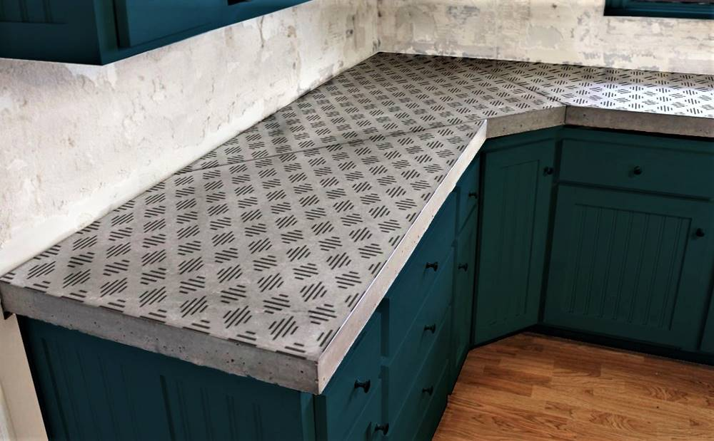 concrete countertop with adhesive-backed stencils placed on them