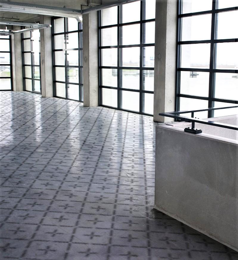 a stenciled concrete space using floormaps geometric patterns