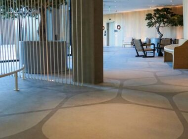 A hotel with stenciled concrete floors