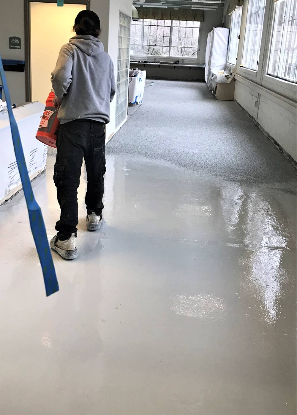 a contractor applying Spartacoat Moisture Vapor Barrier by Laticrete