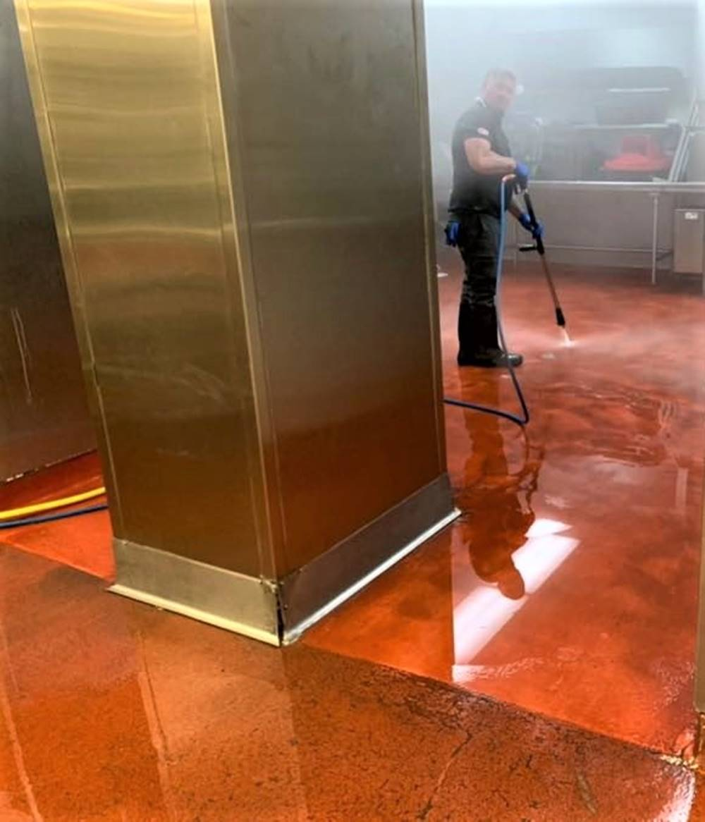 A contractor cleaning the floor at the Mission Inn Hotel & Spa in the kitchen