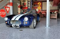 A classic sports car in a garage with epoxy flake