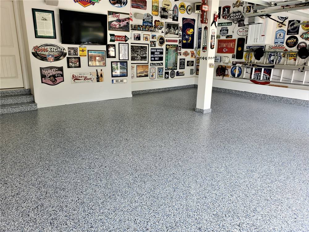 a garage floor with vinyl chips in blues, whites and black