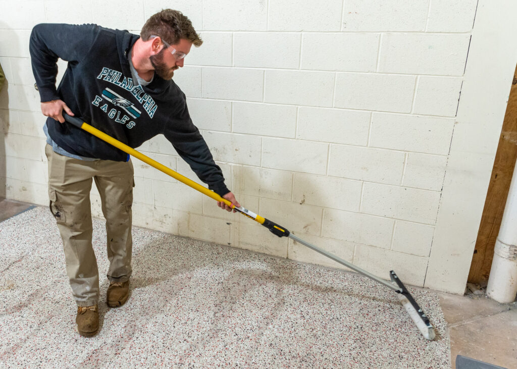 Placing a microtopping with a broom.