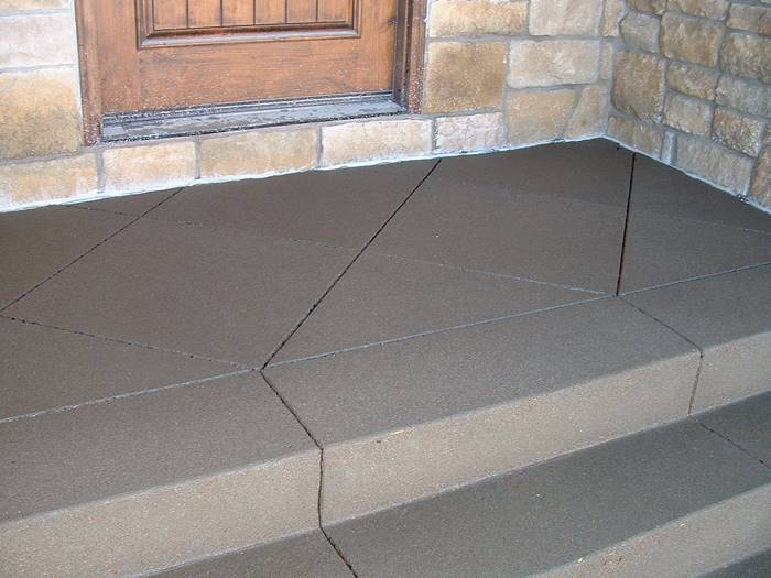 preparing for concrete cracks with decorative saw cuts like seen here serve as control joints on a front stoop.