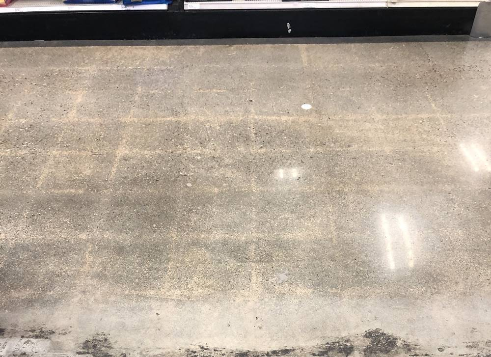 Ghosting images on a concrete floor.