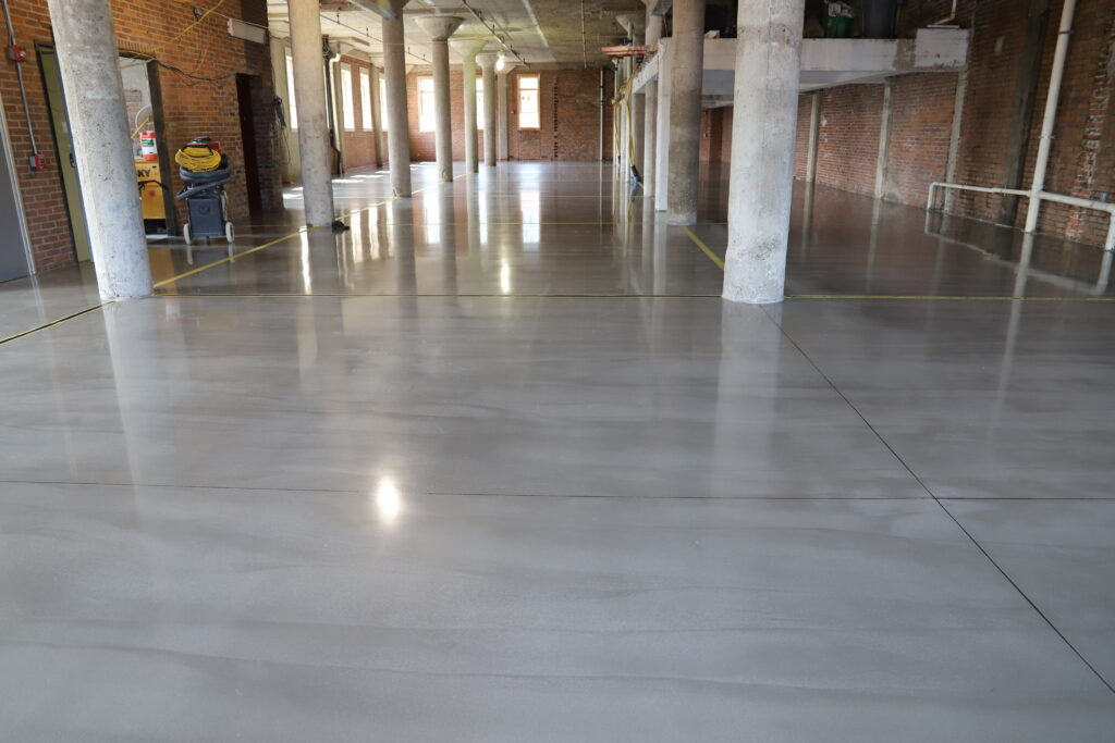A finished polished overlay in a large warehouse space