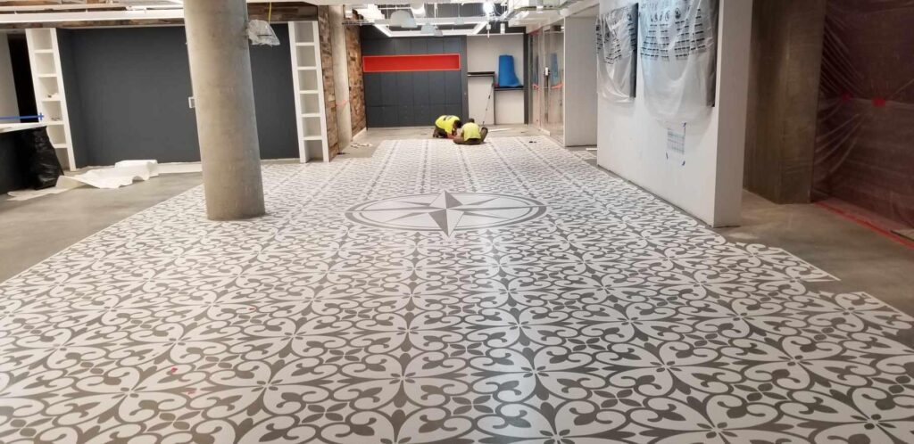 Initially, the stenciled floor featured a crisp white pattern that would be altered to make the floor look worn and faded