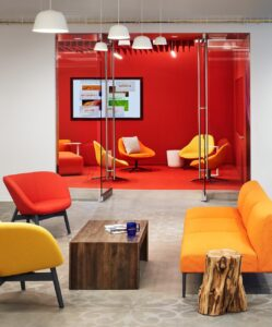 a modern office in reds and oranges with stenciled concrete in an office