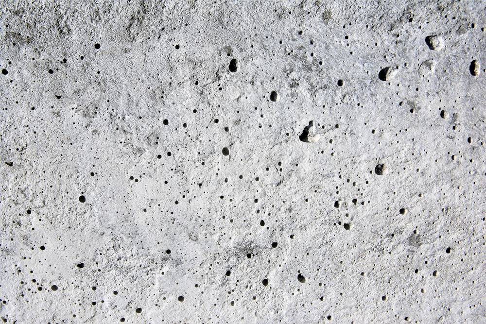 outgassing on a concrete surface causing pinhole effects in the concrete