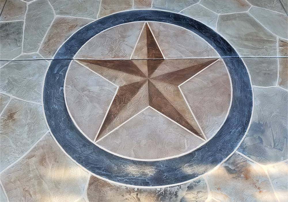 star of Texas on a concrete patio