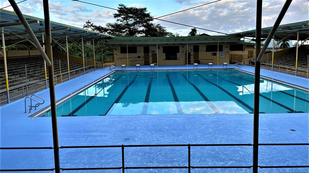 Pool deck that was resurfaced with concrete overlays to remediate cracks