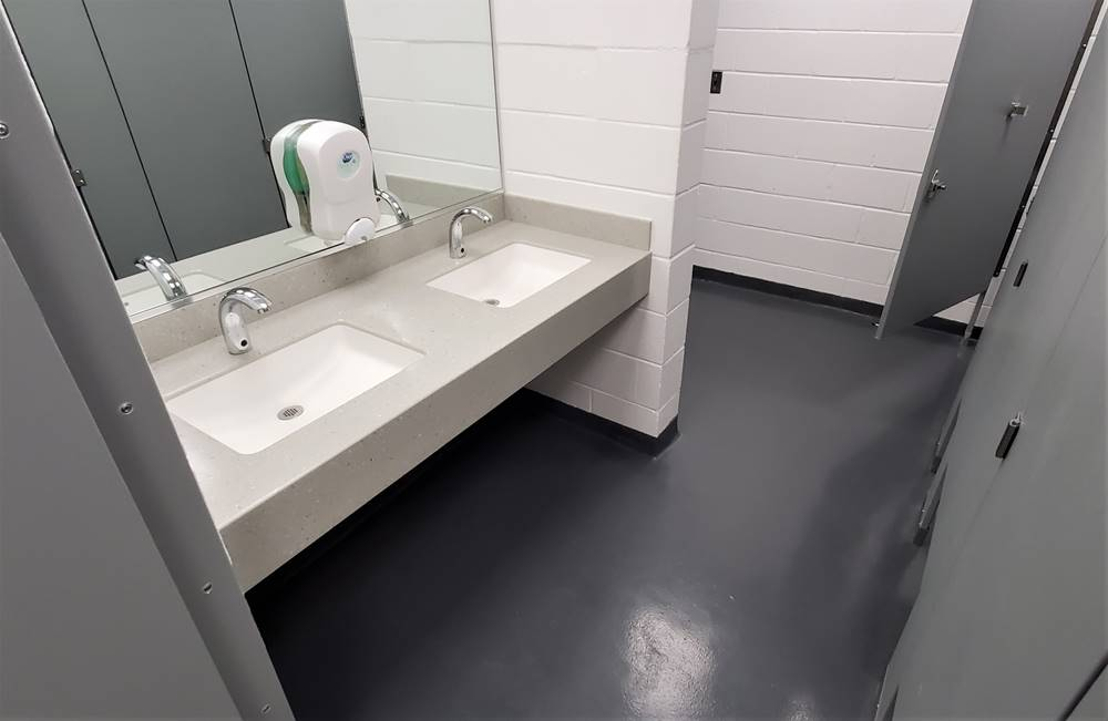 Urethane-modified Concrete in a bathroom at a high school
