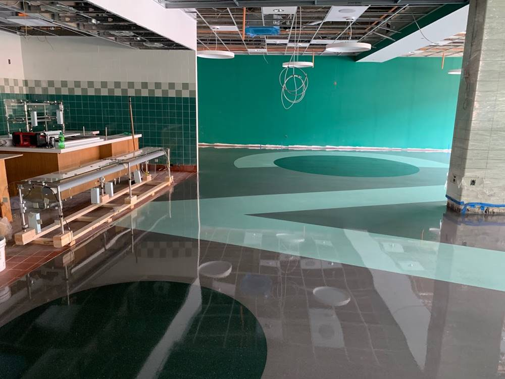 A cafeteria with teal accents