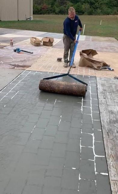 rolling the concrete stencil on fresh concrete