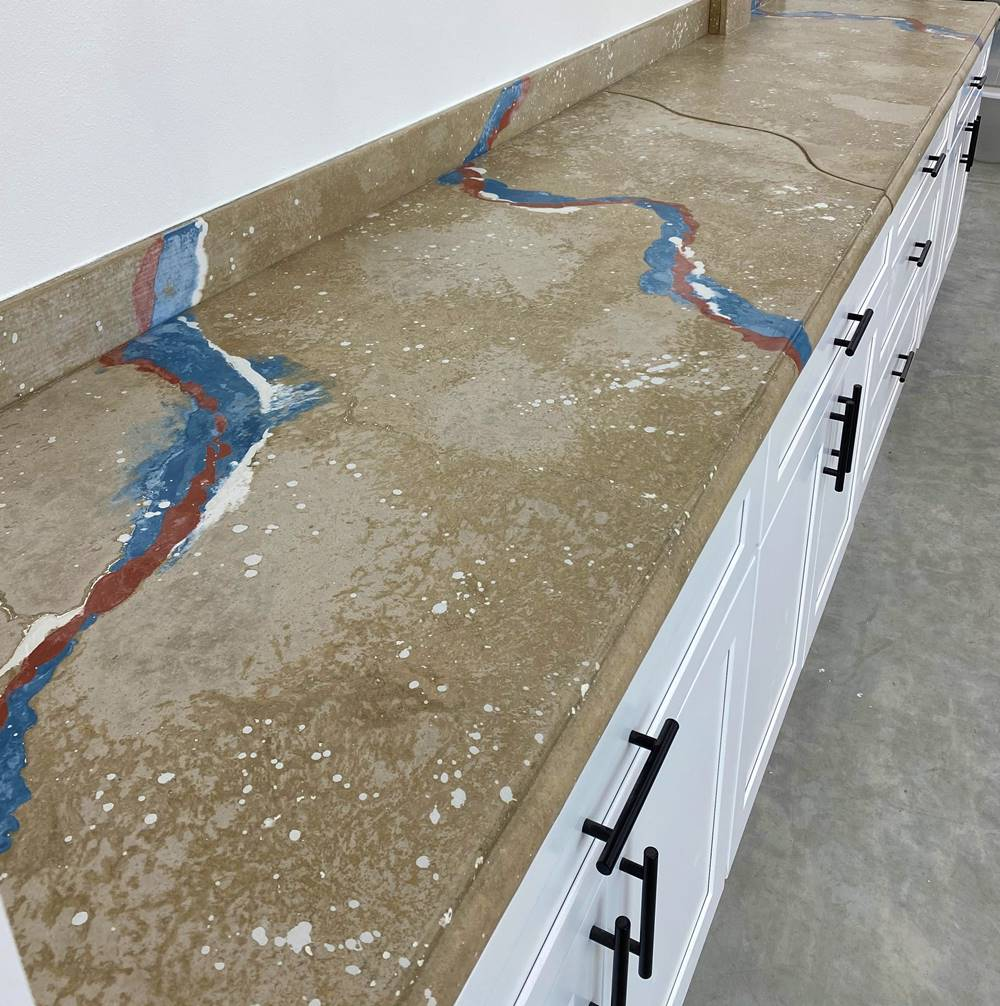 long concrete countertops with blue, white and red veining