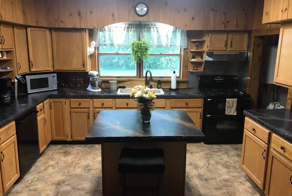 a complete kitchen with concrete countertops including a kitchen island