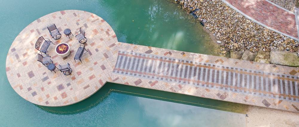 An aerial view of a custom stamped concrete dock