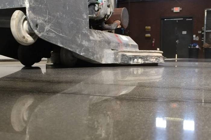 a high-speed burnisher is being used to get more shine on polished concrete
