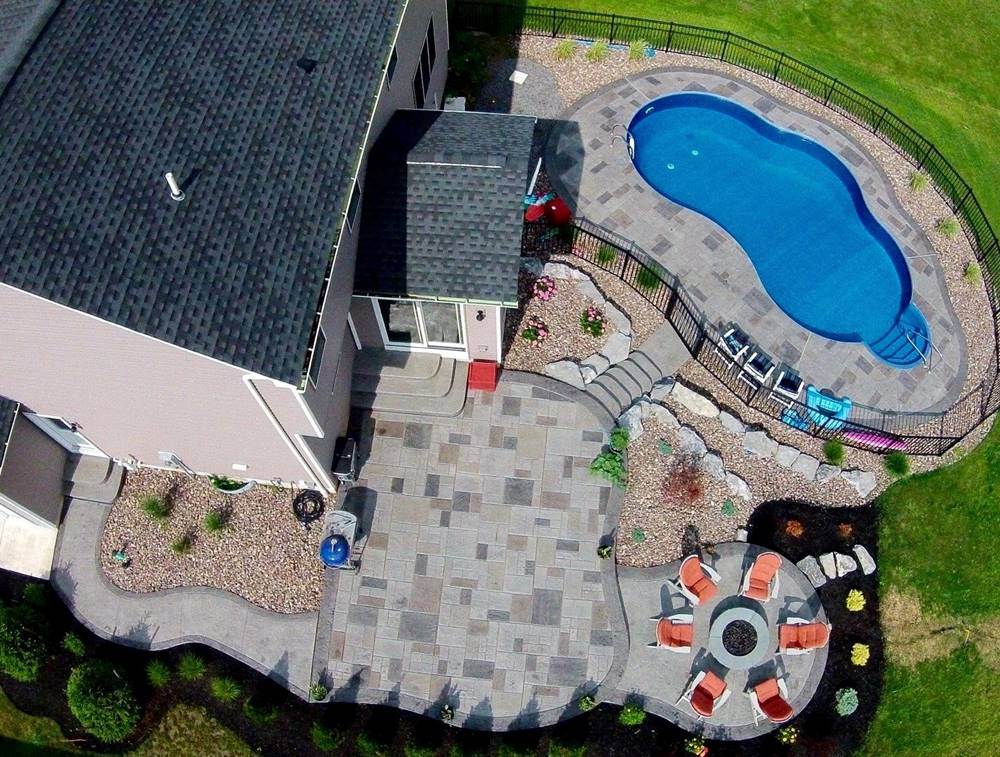 an aerial view of an outdoor concrete patio taken from a drone