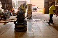 A polishing machine in a warehouse polishing concrete