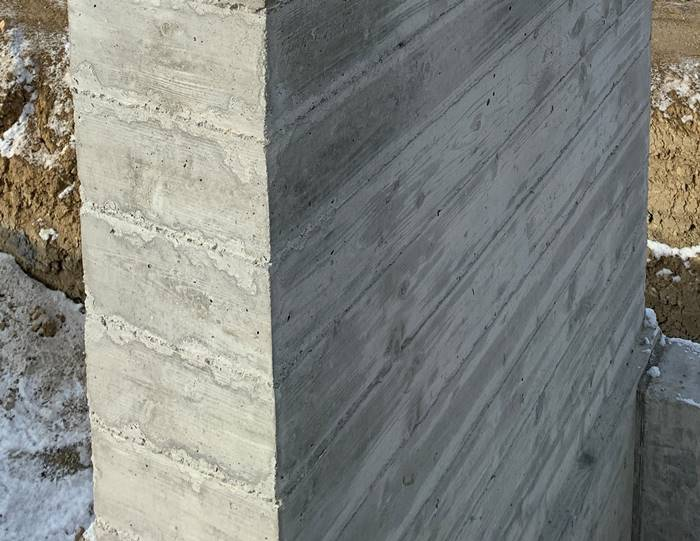 an up close look of wood-look concrete designs in a vertical application