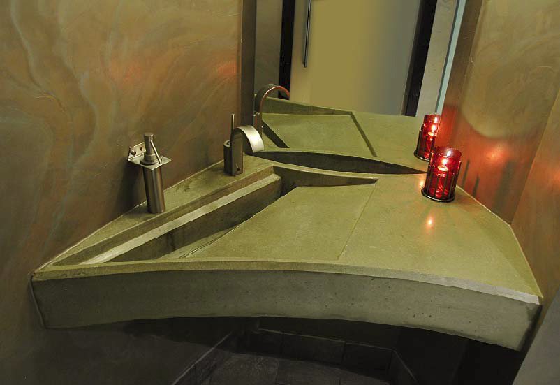 Geometric countertop fits into a small space making for a clever concrete countertop.