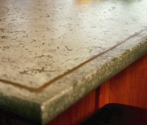 The concrete for this counter was cast upside down and pressed into a form with a copper inlay. The edges were formed with a custom plaster mold.