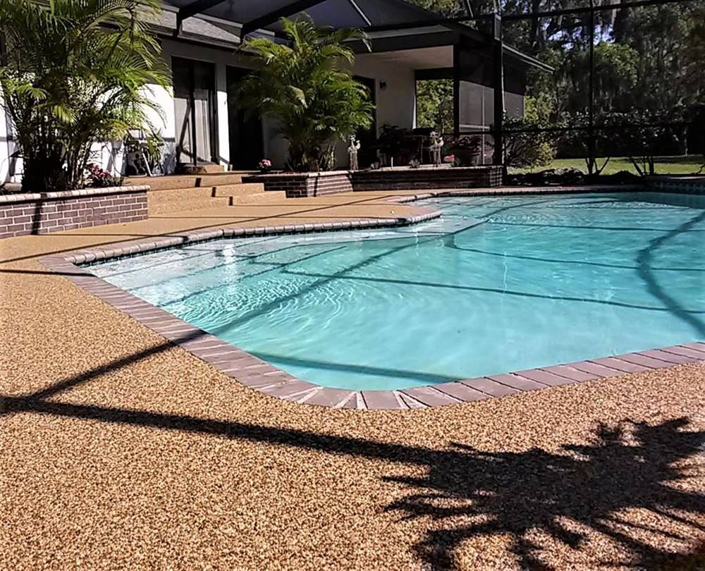 Epoxy Stone placed around a pool on the pool deck
