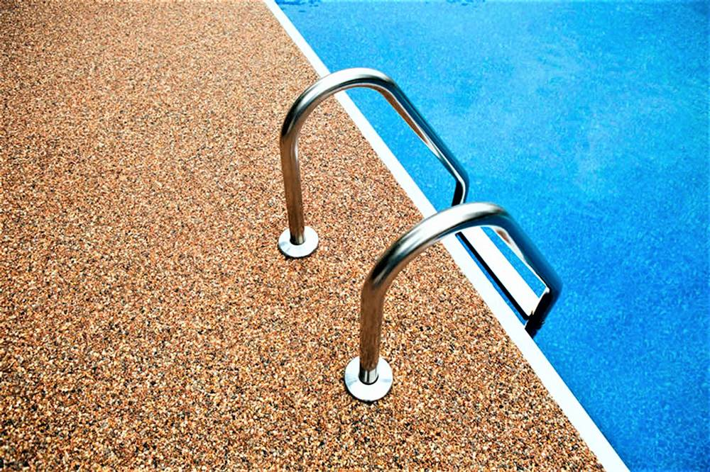 using river rock and epoxy on a pool deck