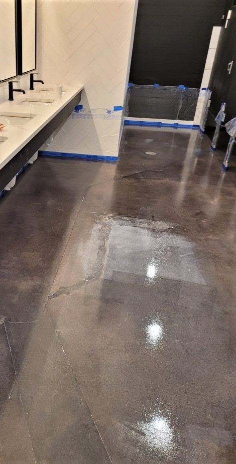 polished concrete that has been sealed in a commercial bathroom