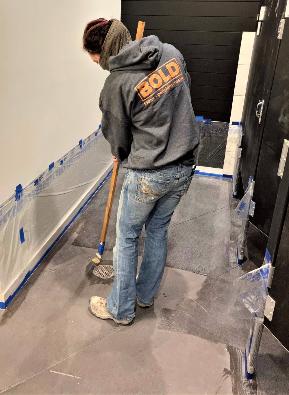contractor applying sealer to a polished concrete floor