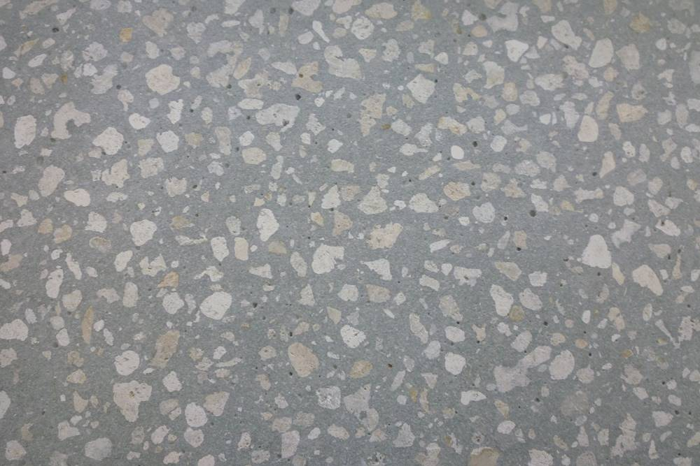 a shot of polishing soft concrete with exposed aggregate limestone