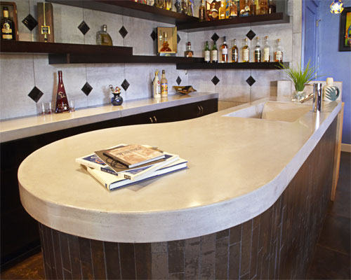 The lower level bar room's main feature is the unique curved shape concrete bar with integral concrete tsunami sink in platinum color.