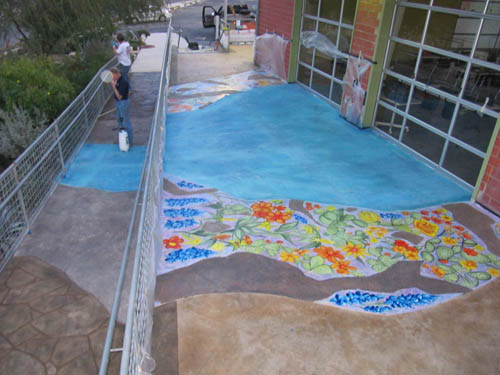 A river was stained on this concrete patio at the entrance of the facility.