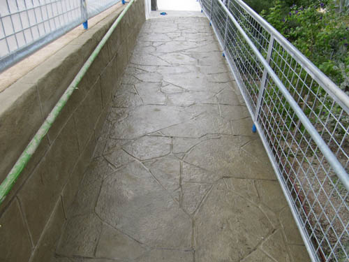 A stamped and stained ADA access ramp.