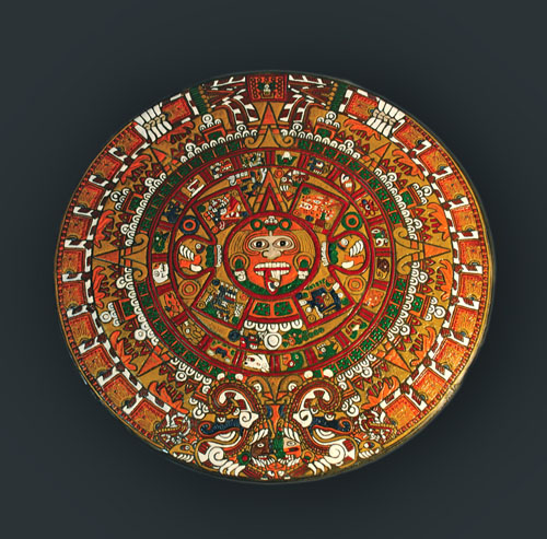 A closer look at the finished Aztec calendar with all its details and colored aspects.