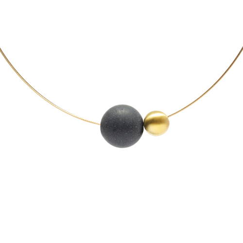 A concrete pendent to be worn around the neck.