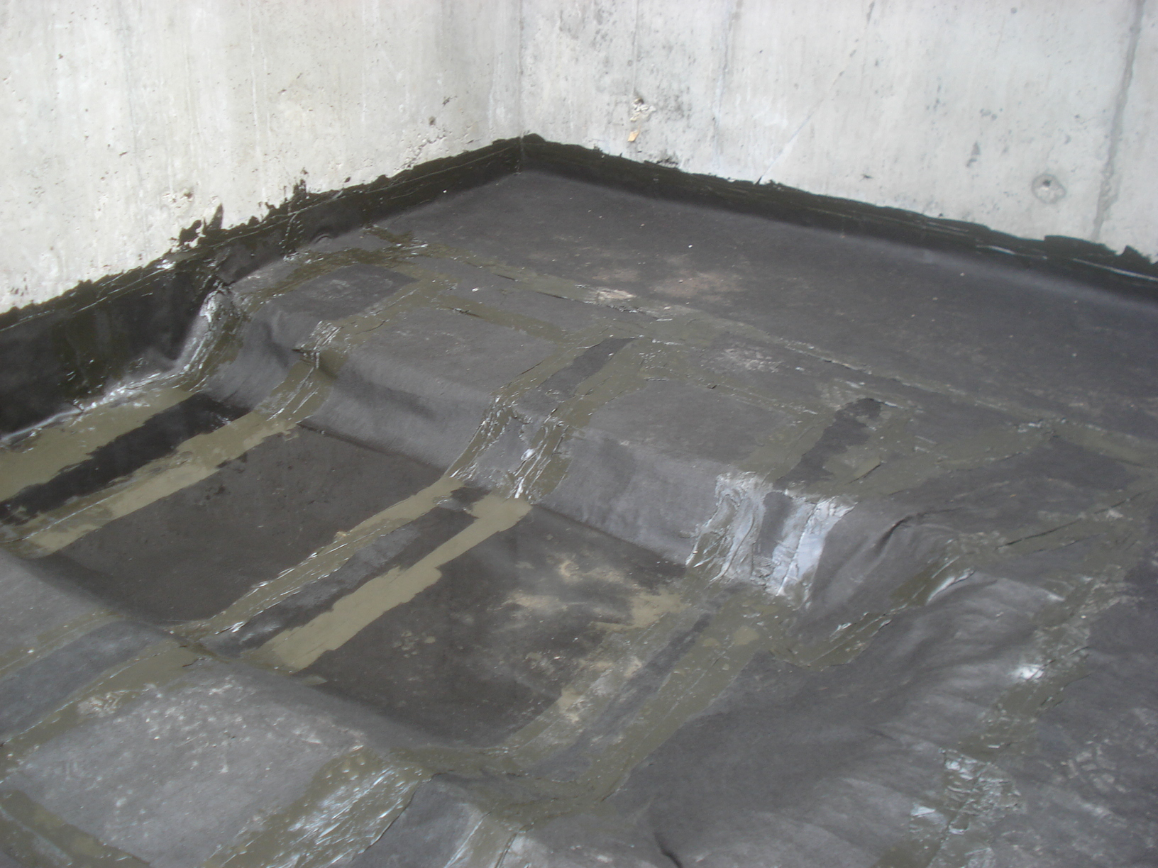 Watson said the Mel-Rol was easily sprayed on the foundation walls, covering all the tiny holes and cracks, forming a good, protective seal between the Mel-Drain and the concrete.