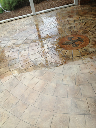 If that had not worked we could have repoured the center and used a custom-made stencil. But it worked great, and the homeowners love their circular stoned floor sunroom.