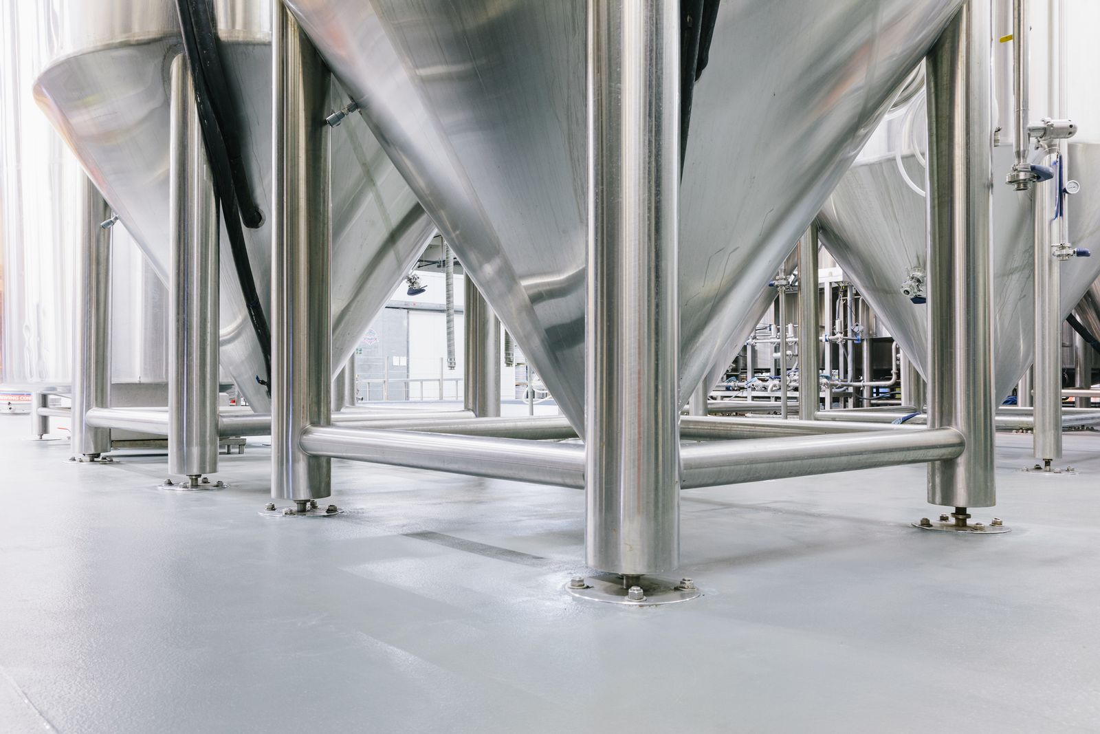 Large brewery drums of beer are placed on concrete floors and the process can affect the sealer.