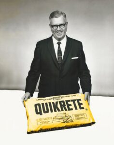 Older gentleman holding a bag of Quikrete.