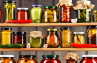 Food in jars on a shelf in a pantry