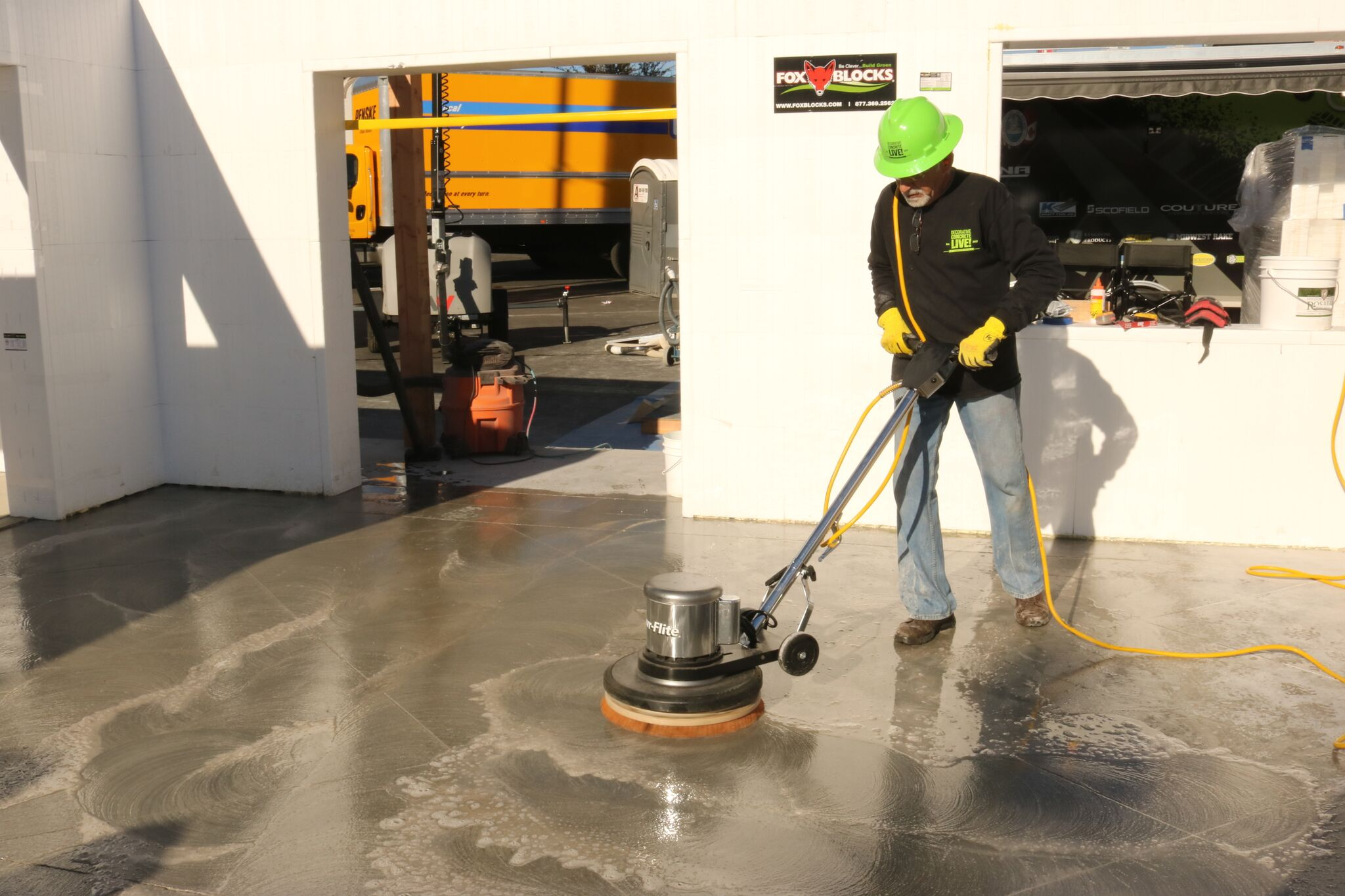 Julio Hallack polishing floor