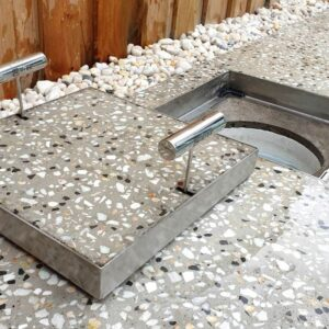 Visually appealing HIDE Skimmer Covers by Concrete Countertop Solutions