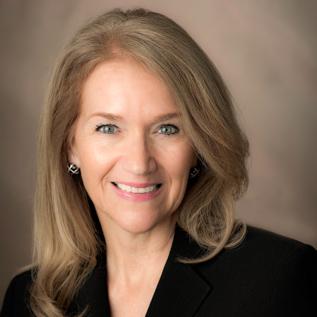first female board chair of NIBS - Annie Ellis
