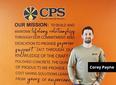 CPS Hires Corey Payne - here Corey Payne poses in front of CPS's mission
