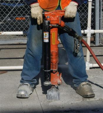 Makinex Lift Assist attached to a jackhammer